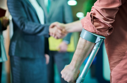 Personal injury lawyer shaking hands with injured client